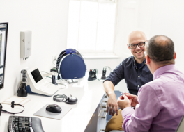 Patient being advised on hearing aids by audiologist