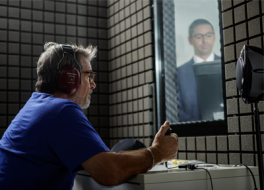 Man having a hearing test in a soundproofed booth